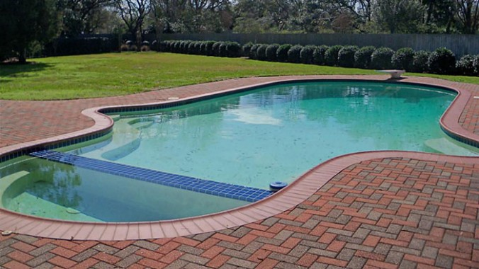 swimming-pool-brown-brick-paving